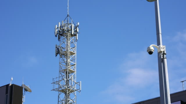 5g tower time lapse with moving clouds - telecommunications equipment stock videos & royalty-free footage