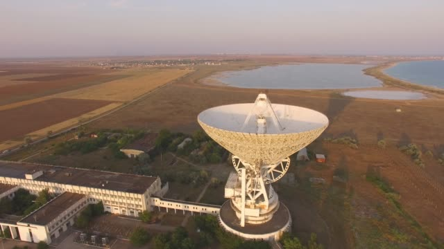 aerial: tower with radar communication system - radio telescope stock videos & royalty-free footage