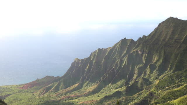 towering peaks of kauai island mountains and clear skies - butte rocky outcrop stock videos & royalty-free footage
