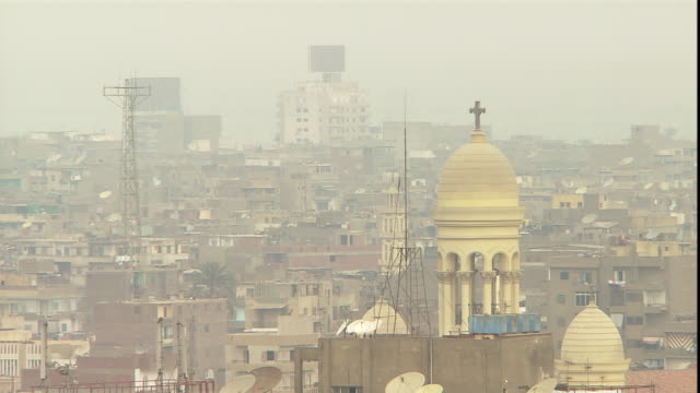 towers and churches and mosques populate cairo's skyline. - air pollution stock videos & royalty-free footage