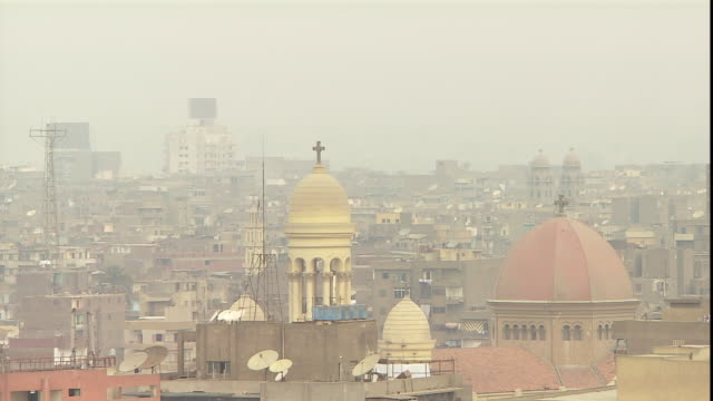 towers and churches jut above cairo's skyline. - air pollution stock videos & royalty-free footage