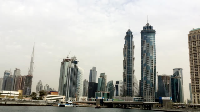 towers and construction sites on waterfront in dubai - national landmark stock videos & royalty-free footage