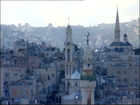 towers and spires of churches crowd the bethlehem skyline. - minareto video stock e b–roll