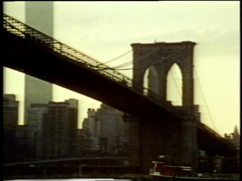 wtc towers at dusk seen from brooklyn with brooklyn bridge in fg.  - 1973 stock videos & royalty-free footage