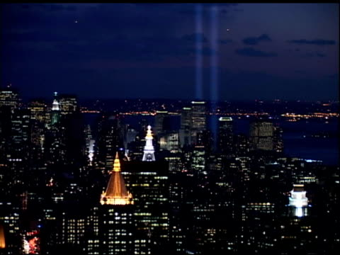 towers of light tribute & lower manhattan at night shot from rooftop near grand central station, empire state building w/ red, white & blue lighting,... - grand central station manhattan stock videos & royalty-free footage