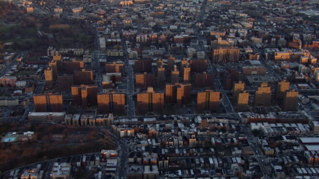 towers of the new york city housing authority rise above the neighboring community in the bronx, new york. - bronx new york stock videos and b-roll footage