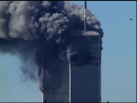 towers on fire zo as helicopter approaches hovers then flies away building water supply tanks on roofs in fg tower 2 collapses w/ shattered glass... - september 11 2001 attacks stock videos & royalty-free footage
