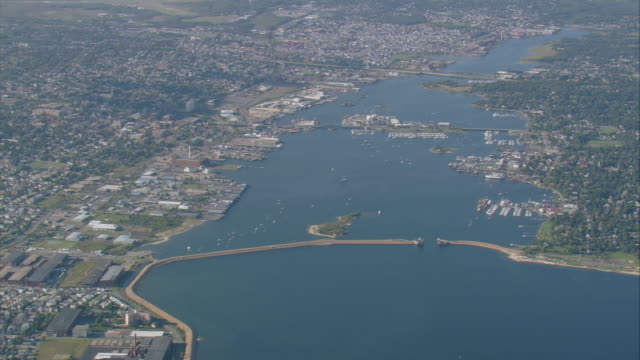 aerial town and breakwater protecting harbor / new bedford, massachusetts, united states - new bedford stock videos & royalty-free footage