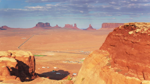 town and buttes in monument valley - navajo reservation stock videos and b-roll footage