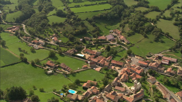 AERIAL WS Town and surrounding green landscape / Cluny, Burgundy, France