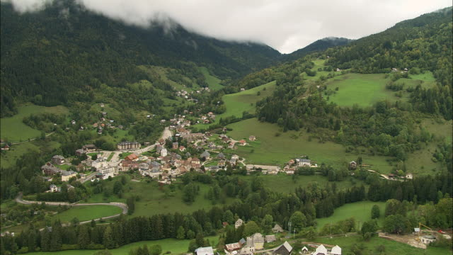 AERIAL WS Town and valley landscape in Chartreuse Mountains / Saint-Pierre-de-Chartreuse, Isere, France