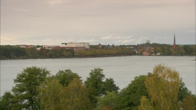 ws ha town bordering lake / vaxjo, sweden - vaxjo stock videos & royalty-free footage