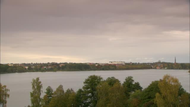ls ws ha town bordering lake / vaxjo, sweden - vaxjo stock videos & royalty-free footage