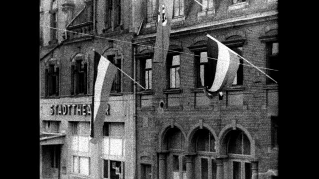 town buildings businesses displaying nazi swastika banners signs saarland poster 'wir wollen heim' countdown calendar for january 13th 1935... - 1934 stock-videos und b-roll-filmmaterial