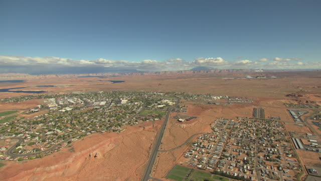 WS AERIAL Town buildings with surrounding desert landscape / Page, Arizona, United States
