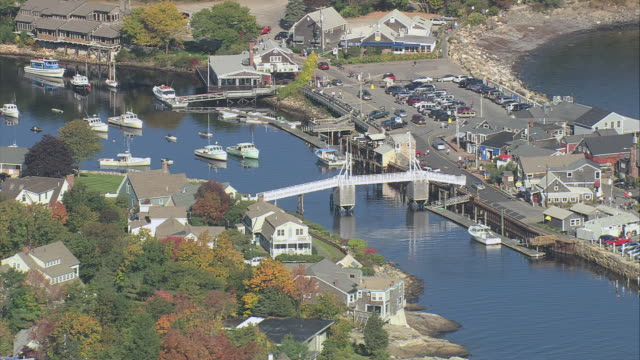 aerial town divided by long narrow cove, crossed over by bridge and with sailboats anchored / ogunquit, maine, united states - anchored stock videos & royalty-free footage