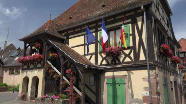 town hall, half-timbered house in medieval village - timber stock-videos und b-roll-filmmaterial