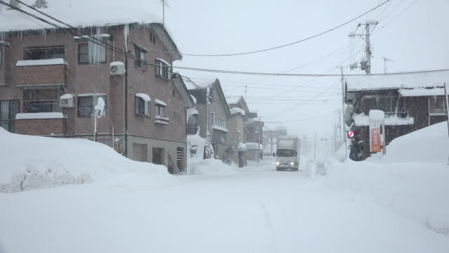 Town hit by major blizzard buried by snow drifts in northern Japan