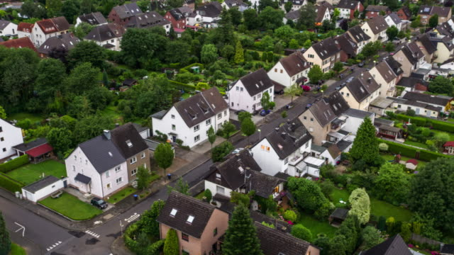 aerial: town houses in suburban area - german culture stock videos & royalty-free footage