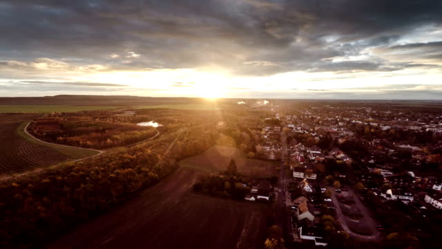 aerial: town in sunrise light - germany - town stock videos & royalty-free footage