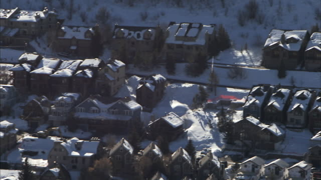 town of park city various houses w/ snow winter ut - park city utah video stock e b–roll