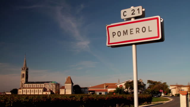 MS Town sign for Pomerol, vineyards and church in background / Aquitaine, France