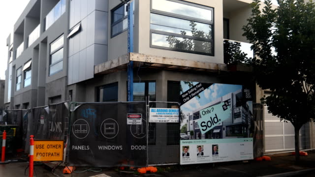 a townhouse complex in kensington is seen nearing completion on july 20 2017 in melbourne australia melbourne house prices have risen consecutively... - housing difficulties stock videos & royalty-free footage