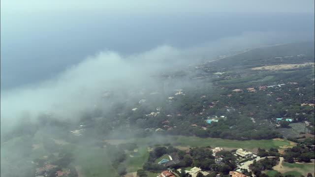 stockvideo's en b-roll-footage met aerial ws pan townscape along coast towards cabo da roca / cascais, lisbon, portugal - roca