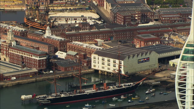 AERIAL Townscape and museum ships HMS Victory and HMS Warrior, Royal Navy's battleship / Portsmouth, Hampshire, United Kingdom