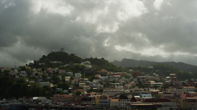ws townscape under cloudy sky / st. georges, grenada, caribbean - st. george's grenada stock videos and b-roll footage