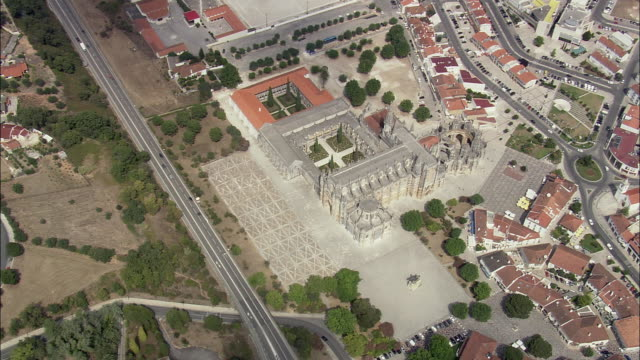 aerial ws zi townscape with batalha monastery / batalha, leria, portugal - circa 14th century stock videos & royalty-free footage