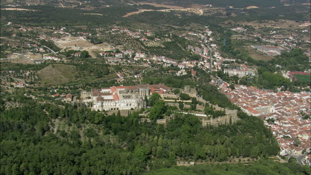 aerial ws townscape with castle and convent of the order of christ / tomar, santarem, portugal - castello video stock e b–roll