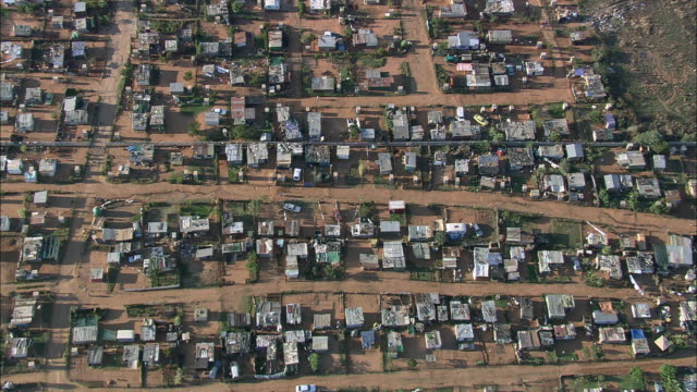 aerial ws zi townscape with one man walking down path, johannesburg, gauteng, south africa - zoom in stock videos & royalty-free footage