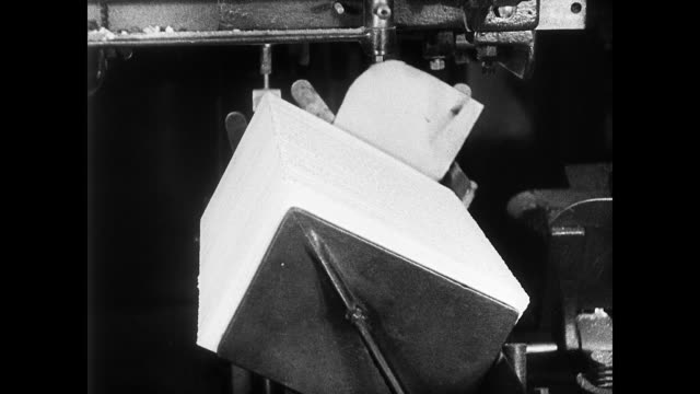 townsend weekly letterhead in typewriter w/ typing of letter. office machine compacting stack of papers. 'diamond' cutting machine slicing end off... - 1935 stock videos & royalty-free footage