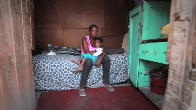 township woman with child - housing difficulties stock videos & royalty-free footage