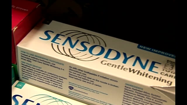 toxic traces found in tubes of fake sensodyne toothpaste england int boxes of sensodyne toothpaste on shop shelf - toothpaste stock videos & royalty-free footage