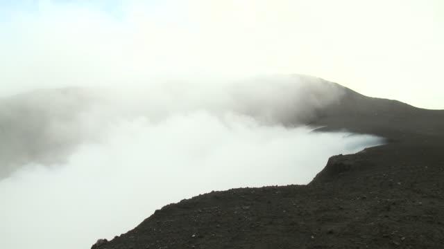 Toxic volcanic gases blow off the edge of crater, Marum Volcano, Ambrym Island, Vanuatu