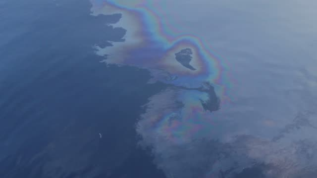 toxic waste and pollution on the sea - oil spill stock videos & royalty-free footage