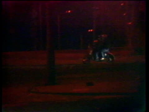 toxteth riots aftermath itn lib liverpool toxteth ms police in silhouette r l fire burns on corner bv police run ms motor scooter manoeuvring r10781... - ブリックストン点の映像素材/bロール