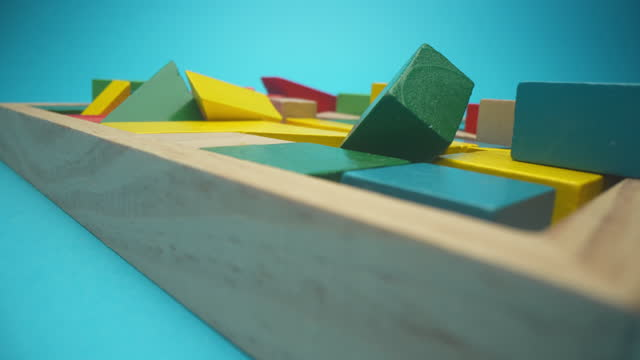 toy blocks in wooden box - turquoise background stock videos & royalty-free footage