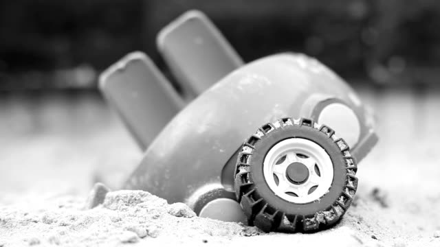 Toy Car On Sand, black and white