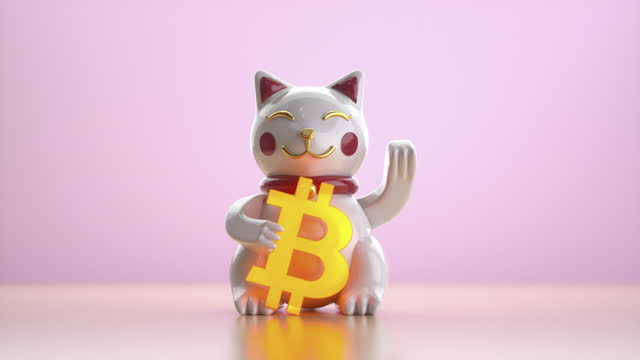 toy cat holding glowing bitcoin sign and waving its paw. - blockchain stock videos & royalty-free footage
