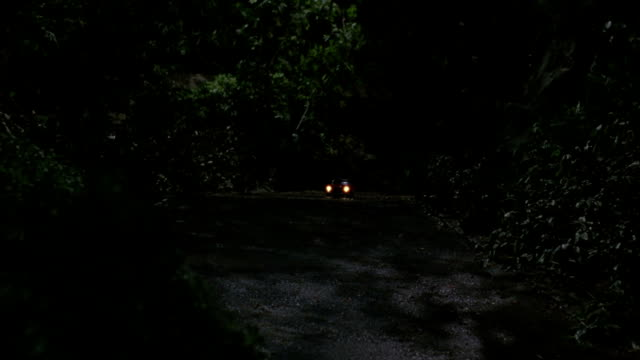 a toy convertible drives along a curvy road. - red convertible stock videos & royalty-free footage