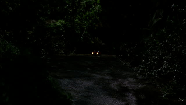 a toy convertible drives down a dimly lit pathway. - red convertible stock videos & royalty-free footage