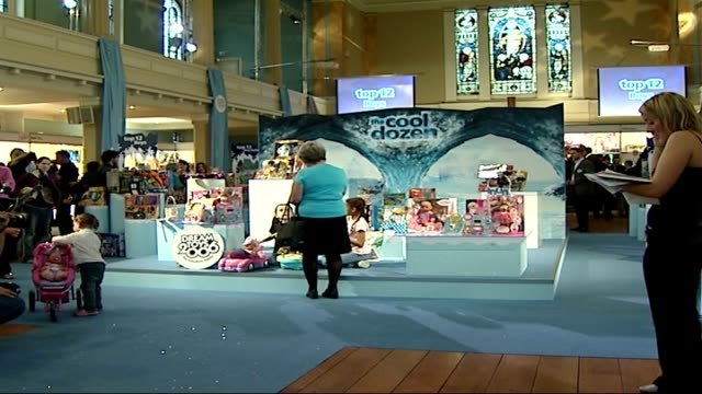 stockvideo's en b-roll-footage met general views of toys on display close up of baby doll being washed by little girl / close up of 'cool dozen' toy display pull out general view of... - noel edmonds