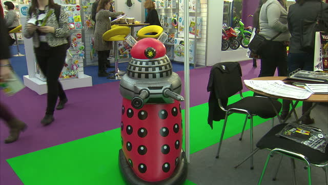 toy industry thriving as displayed at london toy fair. shows interior shots stall with man throwing wicked boomerang & inflatable dalek next to... - boomerang stock videos & royalty-free footage