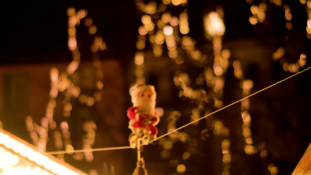 toy nikolaus balancing on string - decorazione natalizia video stock e b–roll