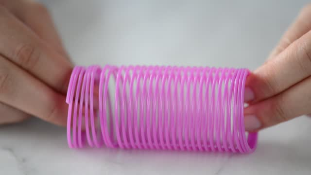 toy plastic slinky - stretching stock videos & royalty-free footage