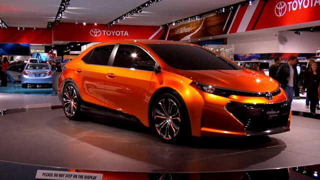 ws toyota corolla furia concept revolving on turntable / cu front end / cu aluminum alloy wheel / cu rear end / cu rear vanity plate passing through... - alloy stock videos & royalty-free footage