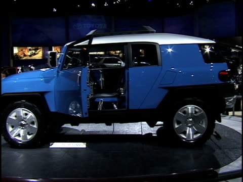 """toyota fj cruiser concept revolving on turntable / rear end passing through frame / interior / supercharged"""" emblem in recessed hood scoop 2003... - audio hardware stock videos & royalty-free footage"""